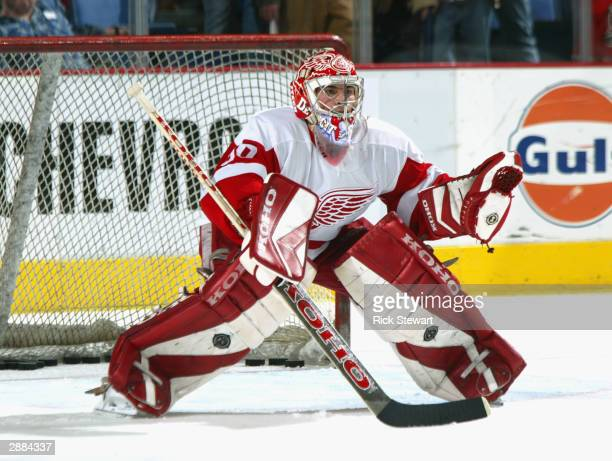Goalie Joey MacDonald of the Detroit Red Wings blocks shot attempts before the start of the game against the Buffalo Sabres on December 10, 2003 at...