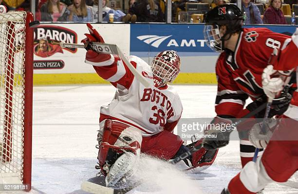 Goalie John Curry of Boston University watches the puck hit the post after a shot by Bryan Esner of Northeastern University at the 2005 Beanpot...