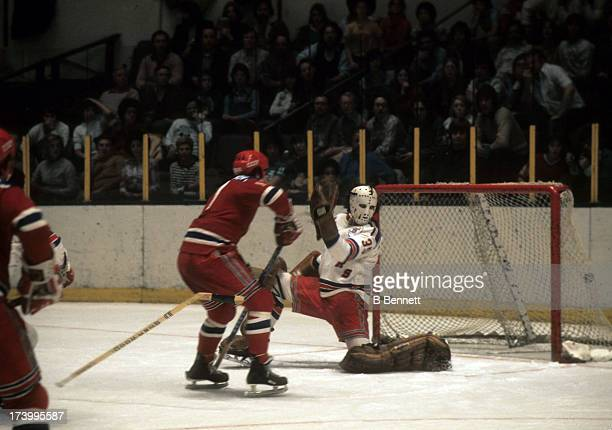 Goalie John Davidson of the New York Rangers can't make the save on Valeri Kharlamov of the Central Red Army during the CSKA Soviet Tour of the NHL...