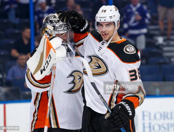 Goalie John Gibson and Derek Grant of the Anaheim Ducks celebrate the win against the Tampa Bay Lightning at Amalie Arena on October 28 2017 in Tampa...