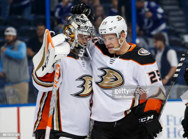 Goalie John Gibson and Ondrej Kase of the Anaheim Ducks celebrate the win against the Tampa Bay Lightning at Amalie Arena on October 28 2017 in Tampa...