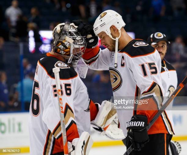 Goalie John Gibson and Ryan Getzlaf of the Anaheim Ducks celebrate the win against the Tampa Bay Lightning at Amalie Arena on October 28 2017 in...