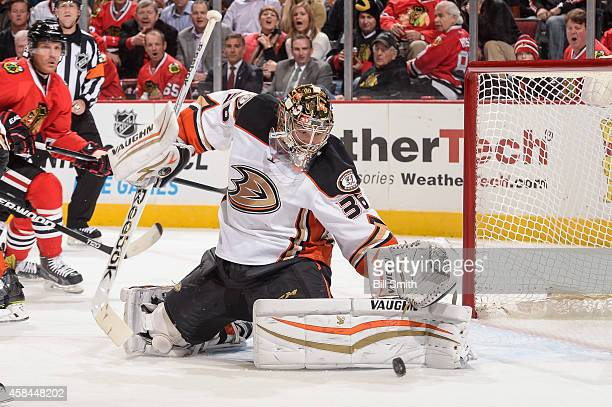 Goalie John Gibson of the Anaheim Ducks deflects the puck during the NHL game against the Chicago Blackhawks on October 28 2014 at the United Center...