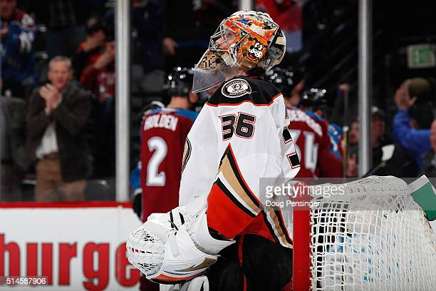 Goalie John Gibson of the Anaheim Ducks looks on as the Colorado Avalanche celebrate a goal by Shawn Matthias of the Colorado Avalanche to take a 30...