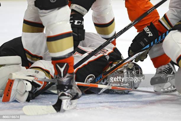 Goalie John Gibson of the Anaheim Ducks makes a save and covers the puck against the Philadelphia Flyers during the second period at Wells Fargo...