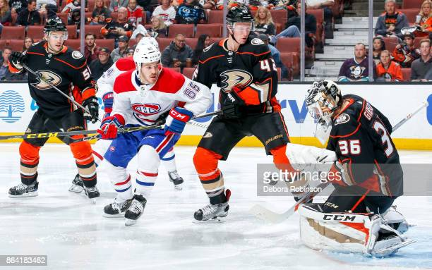 Goalie John Gibson of the Anaheim Ducks makes a save as Andrew Shaw of the Montreal Canadiens and Antoine Vermette and Josh Manson of the Anaheim...