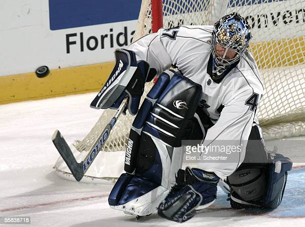 Goalie John Grahame of the Tampa Bay Lightning makes a save against the Florida Panthers on October 2 2005 at the Bank Atlantic Center in Sunrise...