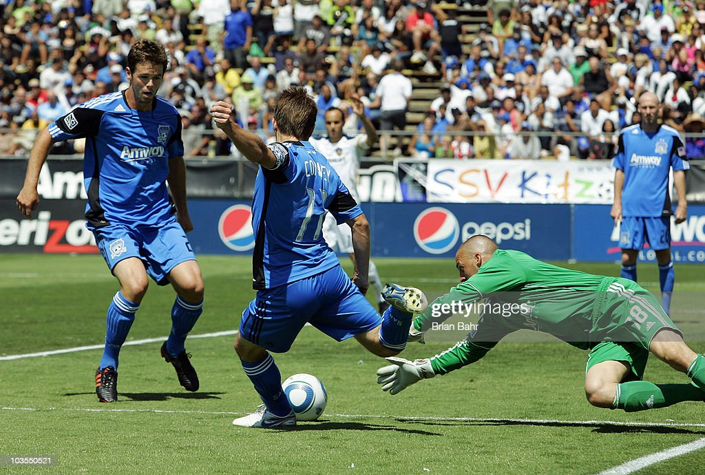 Goalie Jon Busch #18 of the San Jose Earthquakes dives for the ball as Bobby Convey #11 clears it against the Los Angeles Galaxy on August 21, 2010 at Buck Shaw Stadium in Santa Clara, California. The Earthquakes won 1-0.