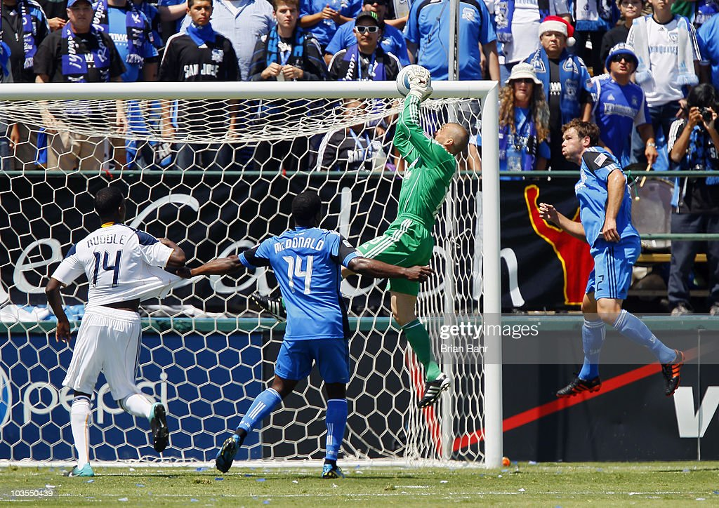 Goalie Jon Busch #18 of the San Jose Earthquakes grabs a shot on goal against Edson Buddle #14 of the Los Angeles Galaxy on August 21, 2010 at Buck Shaw Stadium in Santa Clara, California. The Earthquakes won 1-0.