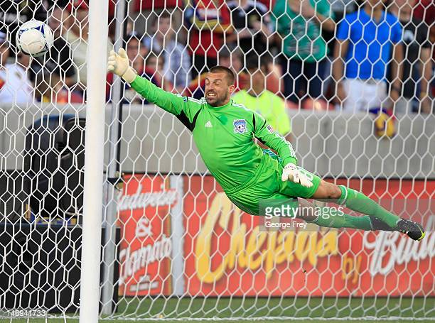 Goalie Jon Busch of the San Jose Earthquakes lets a ball by for a goal against Real Salt Lake during the second half of an MLS soccer game June 23...