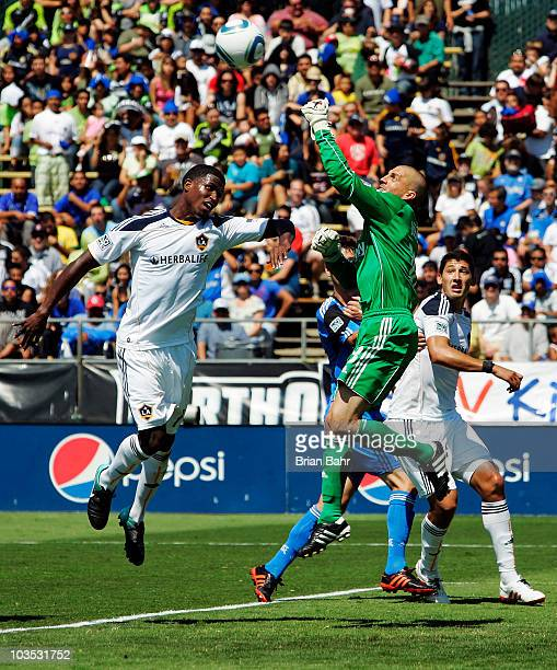 Goalie Jon Busch of the San Jose Earthquakes punches the ball away from Edson Buddle of the Los Angeles Galaxy on August 21 2010 at Buck Shaw Stadium...