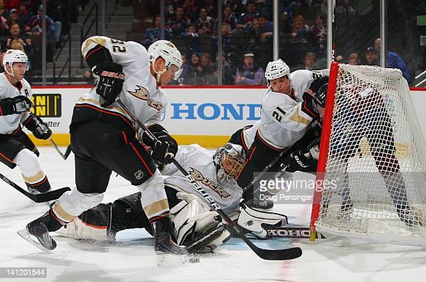 Goalie Jonas Hiller of the Anaheim Ducks defends the goal while Toni Lydman of the Anaheim Ducks clears the puck and Sheldon Brookbank of the Anaheim...