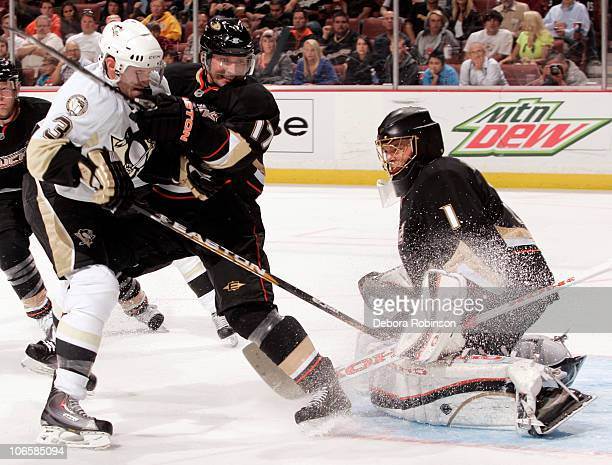 Goalie Jonas Hiller of the Anaheim Ducks defends the net as teammate Lubomir Visnovsky battles Alex Goligoski of the Pittsburgh Penguins on November...