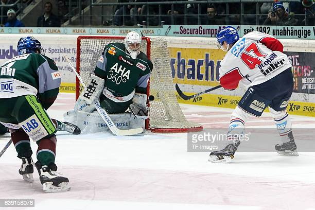 Goalie Jonathan Boutin of Augsburger Panther and Christoph Ullmann of Adler Mannheim battle for the ball during the DEL match between Augsburg...
