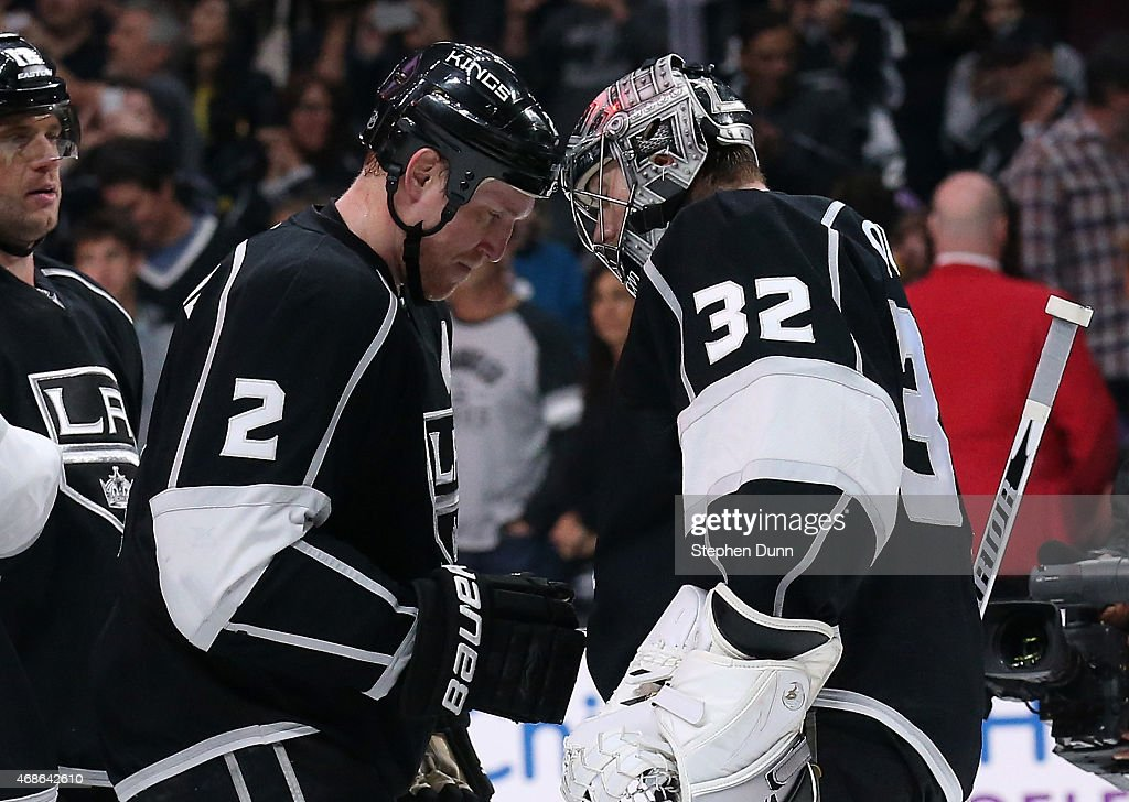 Goalie Jonathan Quick #32 and Matt Greene #2 of the Los Angeles Kings bump helmets as they celebrate after the game againstthe Colorado Avalanche at Staples Center on April 4, 2015 in Los Angeles, California. The Kings won 3-1.