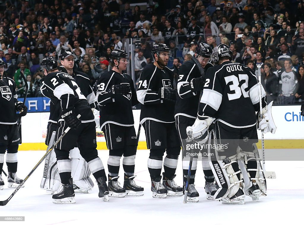 Goalie Jonathan Quick #32 of the Los Angeles Kings celebrates with teammates after the game against the Colorado Avalanche at Staples Center on April 4, 2015 in Los Angeles, California. The Kings won 3-1.