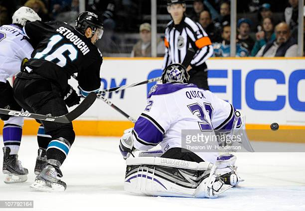 Goalie Jonathan Quick of the Los Angeles Kings make a save on the shot of Devin Setoguchi of the San Jose Sharks during an NHL hockey game at the HP...
