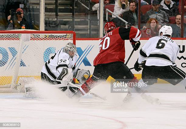 Goalie Jonathan Quick of the Los Angeles Kings makes a save on the shot attempt by Antoine Vermette of the Arizona Coyotes as Jake Muzzin of the...