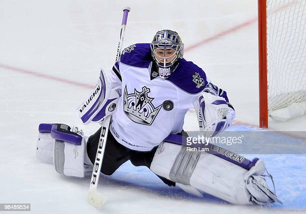 Goalie Jonathan Quick of the Los Angeles Kings slides across his crease to make a save against the Vancouver Canucks during the overtime period in...