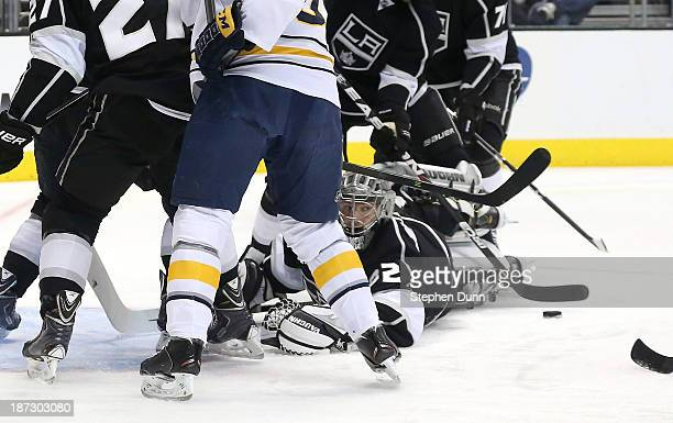 Goalie Jonathan Quick of the Los Angeles Kings spawls on the ice in front of the puck against the Buffalo Sabres at Staples Center on November 7 2013...