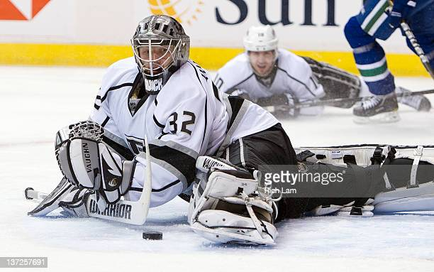 Goalie Jonathan Quick of the Los Angeles Kings stretches out to make a save against the Vancouver Canucks while Mike Richards of the Los Angeles...