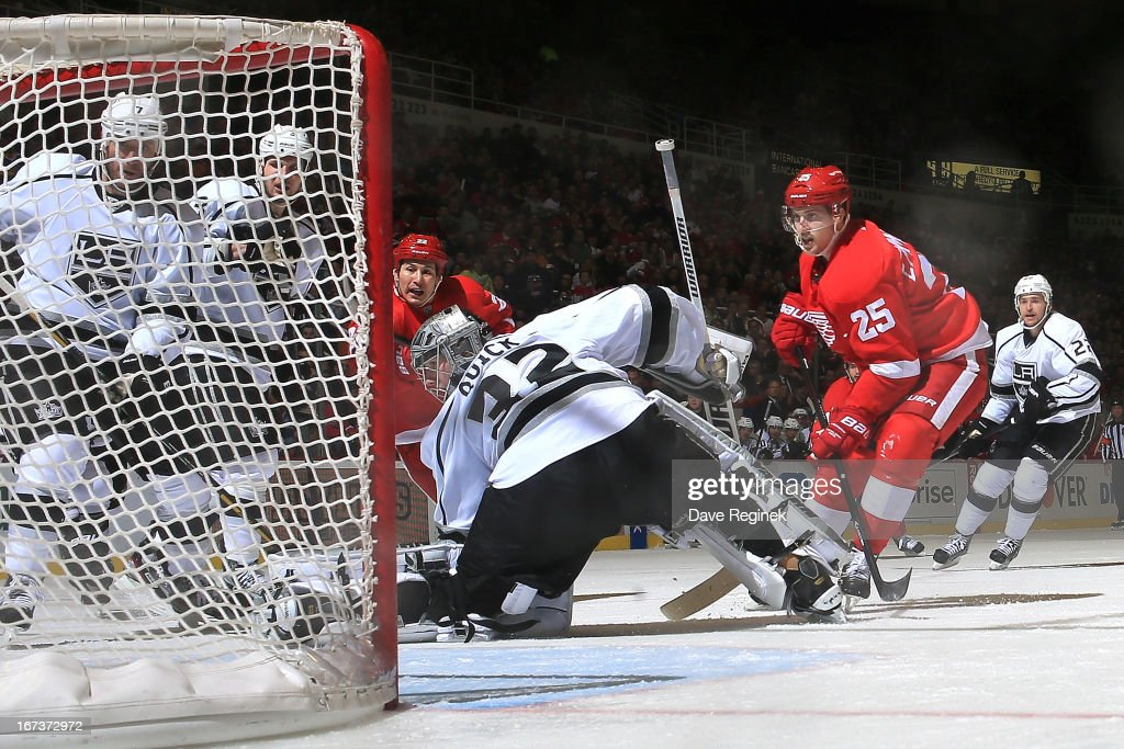 Goalie Jonathan Quick #32, Rob Scuderi #7 and Kyle Clifford #13 of the Los Angeles Kings as well as Joordin Tootoo #22 and Cory Emmerton #25 of the Detroit Red Wings watch as the puck goes to the back of the net for the game winning goal (shot deflection from Tootoo) during a NHL game at Joe Louis Arena on April 24, 2013 in Detroit, Michigan. Detroit defeated Los Angeles 3-1