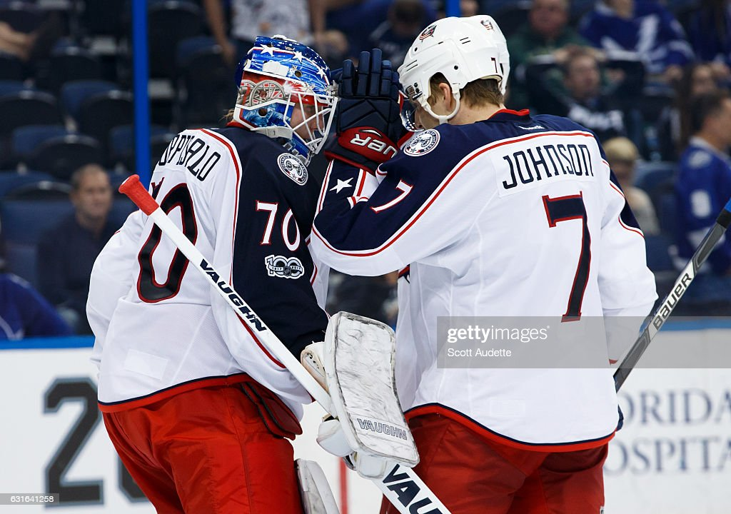 Goalie Joonas Korpisalo #70 and Jack Johnson #7 of the Columbus Blue Jackets celebrate the win against the Tampa Bay Lightning at Amalie Arena on January 13, 2017 in Tampa, Florida.