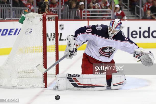 Goalie Joonas Korpisalo of the Columbus Blue Jackets blocks a shot in the second period against the Washington Capitals at Capital One Arena on...
