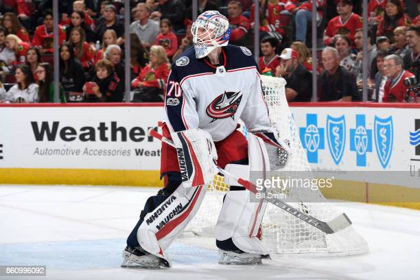 Goalie Joonas Korpisalo of the Columbus Blue Jackets looks up the ice during the game against the Chicago Blackhawks at the United Center on October...