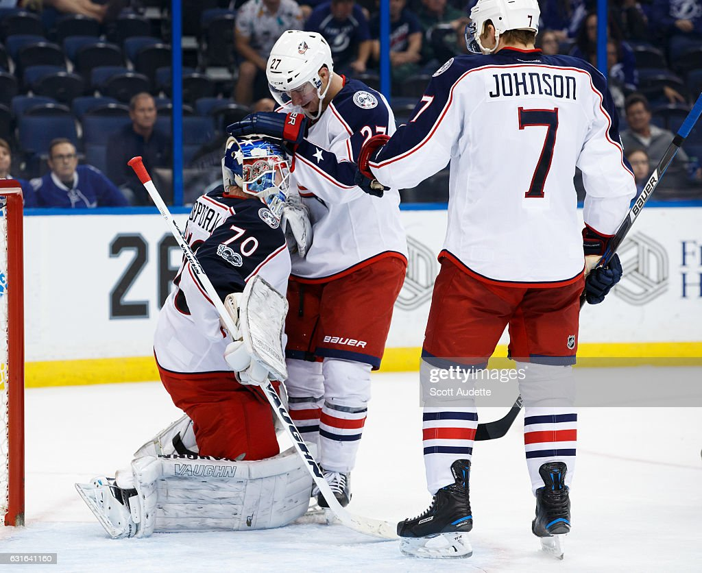 Goalie Joonas Korpisalo #70, Ryan Murray #27, and Jack Johnson #7 of the Columbus Blue Jackets celebrate the win against the Tampa Bay Lightning at Amalie Arena on January 13, 2017 in Tampa, Florida.