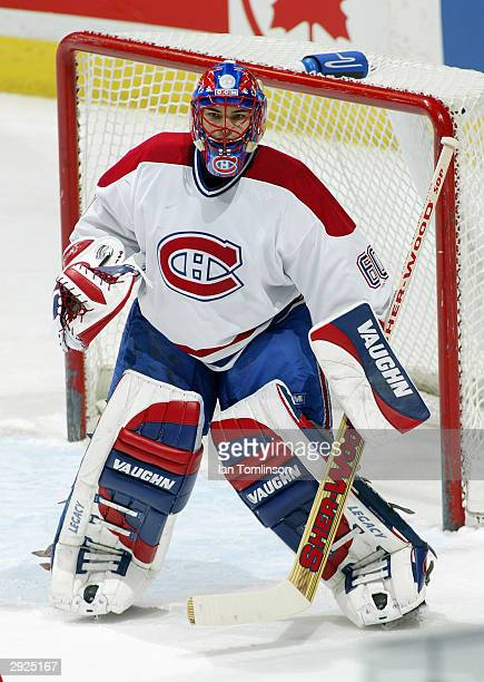Goalie Jose Theodore of the Montreal Canadians protects the net from the Calgary Flames at Pengrowth Saddledome on November 20 2003 in Calgary...