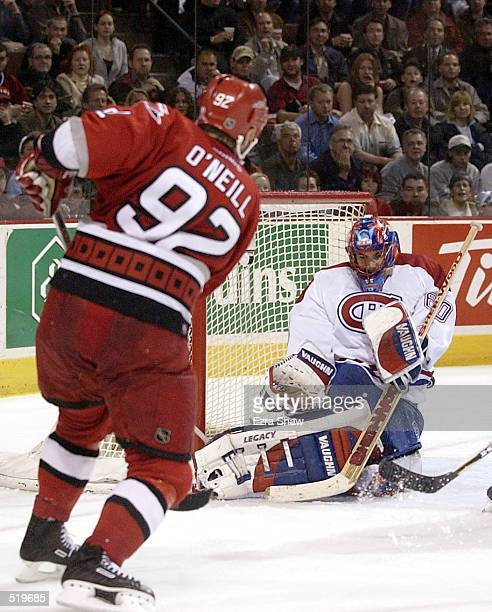 Goalie Jose Theodore of the Montreal Canadiens makes a save on a shot taken by Jeff O'Neill of the Carolina Hurricanes during the second period of...