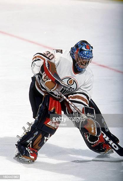 Goalie Jussi Markkanen moves the puck during a pre-season game in September, 2001 at the Skyreach Centre in Edmonton, Alberta, Canada.