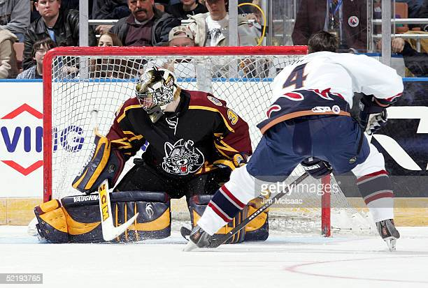 Goalie Kari Lehtonen of the Chiacago Wolves makes a save against defenseman Brad Tiley of the Milwaukee Admirals during the breakaway relay at the...