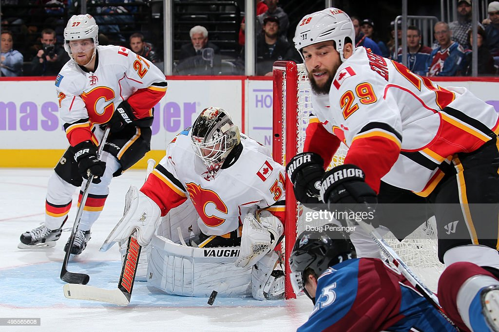 Goalie Karri Ramo #31 of the Calgary Flames turns the puck away as Deryk Engelland #29 of the Calgary Flames defends against the shot by Mikhail Grigorenko #25 of the Colorado Avalanche as Dougie Hamilton #27 of the Calgary Flames follows the play at Pepsi Center on November 3, 2015 in Denver, Colorado. The Avalanche defeated the Flames 6-3.