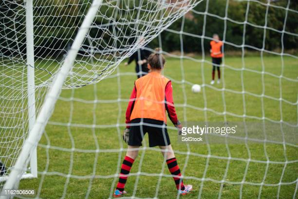 goalie keeping an eye on the football - try scoring stock pictures, royalty-free photos & images
