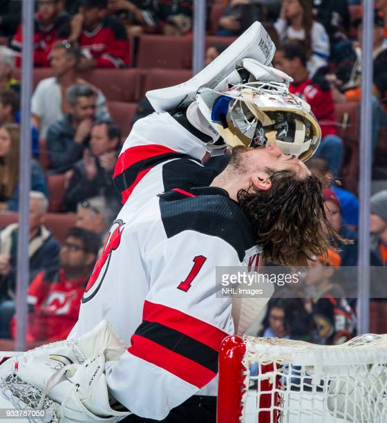 Goalie Keith Kinkaid of the New Jersey Devils removes his helmet during the first period of the game against the Anaheim Ducks at Honda Center on...