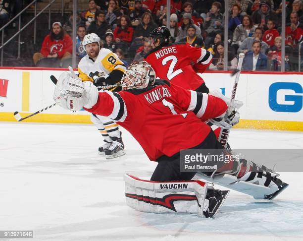 Goalie Keith Kinkaid of the New Jersey Devils stretches for a shot by Phil Kessel of the Pittsburgh PenguiBrian Dumoulin of the Pittsburgh Penguins...