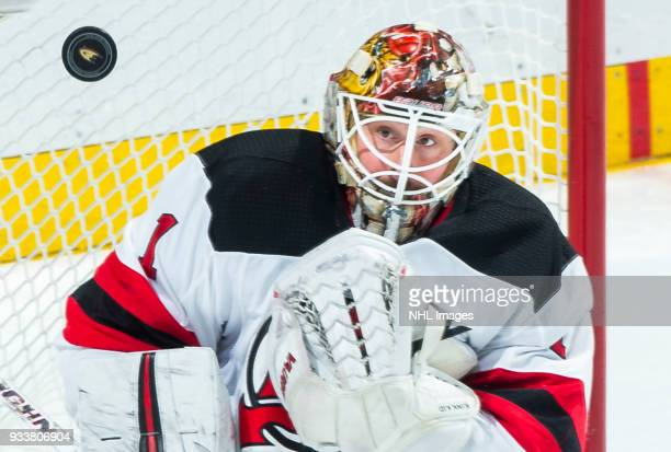 Goalie Keith Kinkaid of the New Jersey Devils watches the puck during the second period of the the game against the Anaheim Ducks at Honda Center on...