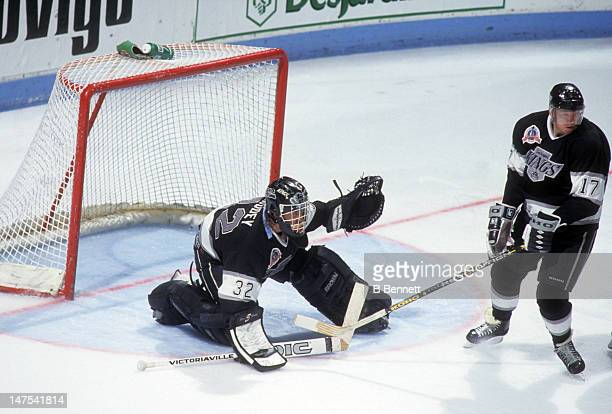Goalie Kelly Hrudey and teammate Jari Kurri of the Los Angeles Kings defend the net during the 1993 Stanley Cup Finals against the Montreal Canadiens...