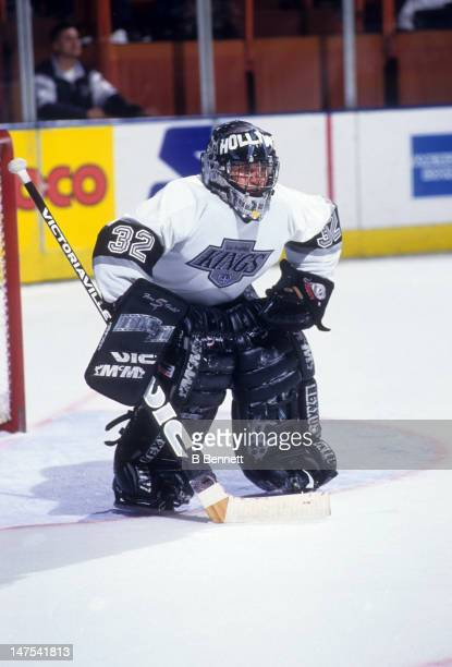 Goalie Kelly Hrudey of the Los Angeles Kings defends the net during an NHL game circa 1995 at the Great Western Forum in Inglewood California