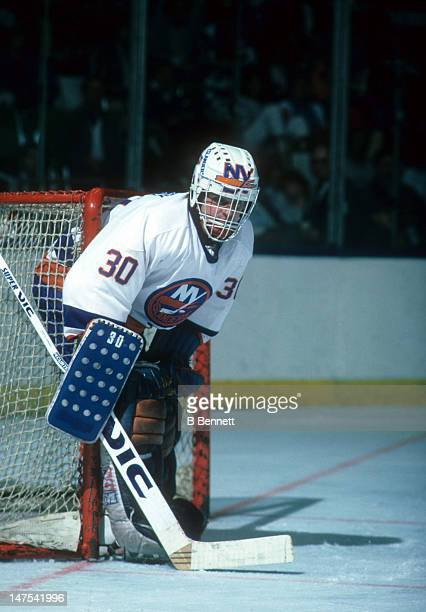 Goalie Kelly Hrudey of the New York Islanders defends the net during an NHL game in November 1985 at the Nassau Coliseum in Uniondale New York