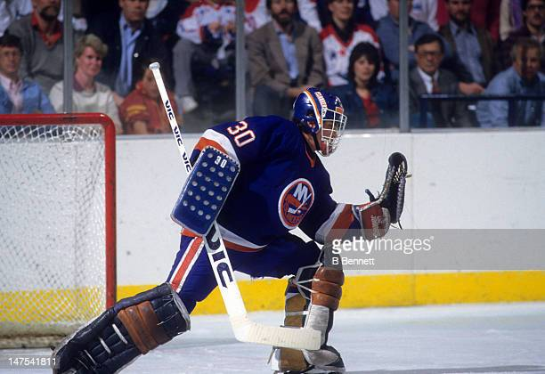 Goalie Kelly Hrudey of the New York Islanders makes the glove save during the 1985 Eastern Division Semi Finals against the Washington Capitals in...