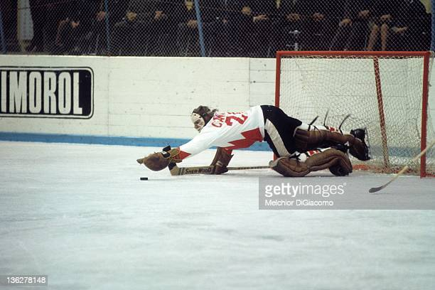 Goalie Ken Dryden of Canada dives to cover the puck during the game against the Soviet Union in the 1972 Summit Series at the Luzhniki Ice Palace in...