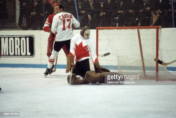 Goalie Ken Dryden of Canada makes the save as his teammate Bill White blocks out Alexander Yakushev of the Soviet Union during the 1972 Summit Series...