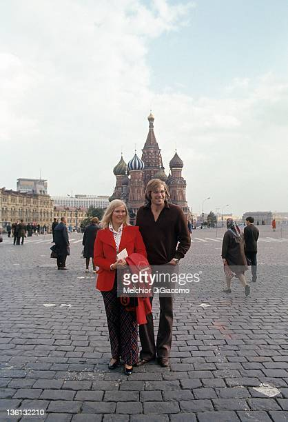 Goalie Ken Dryden of Canada poses for a portrait with his wife in front of the Kremlin between games during the 1972 Summit Series in Moscow Russia