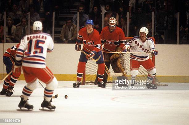 Goalie Ken Dryden of the Montreal Canadiens follows the play as his teammate Brian Engblom defends against Eddie Johnstone of the New York Rangers...