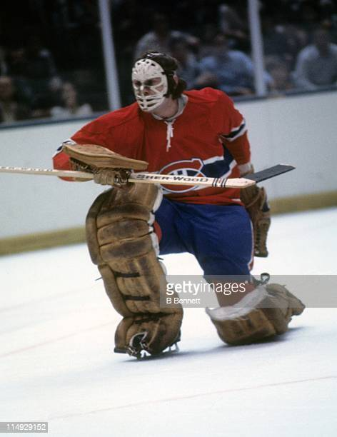 Goalie Ken Dryden of the Montreal Canadiens kneels on the ice during an NHL game circa 1976