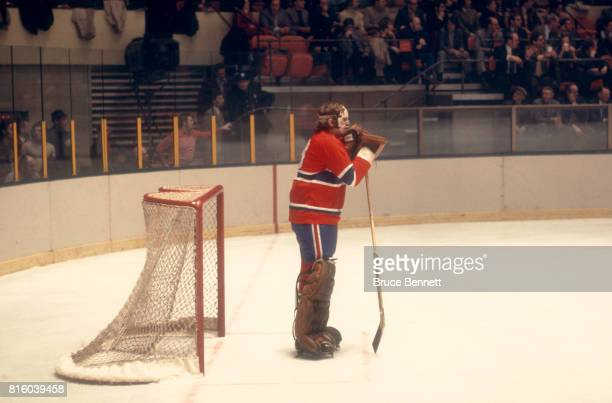 Goalie Ken Dryden of the Montreal Canadiens leans on his goalie stick during an NHL game against the New York Rangers circa 1973 at Madison Square...