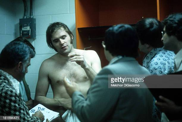1975 Goalie Ken Dryden of the Montreal Canadiens talks to the media in the locker room after an NHL game circa 1975
